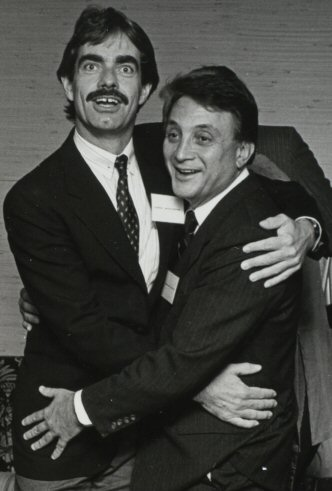Jerry Northern (left) expresses his thanks to Chuck Berlin (right) for writing the lyrics to Acronym Jim